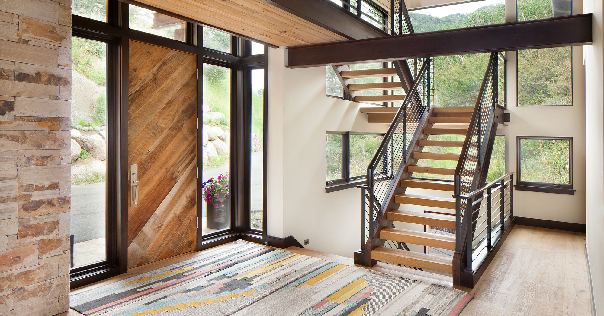 Custom Staircase and steel beams mountain house