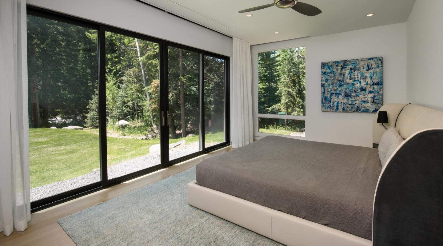 East Vail Mountain Modern featured bedroom on creek