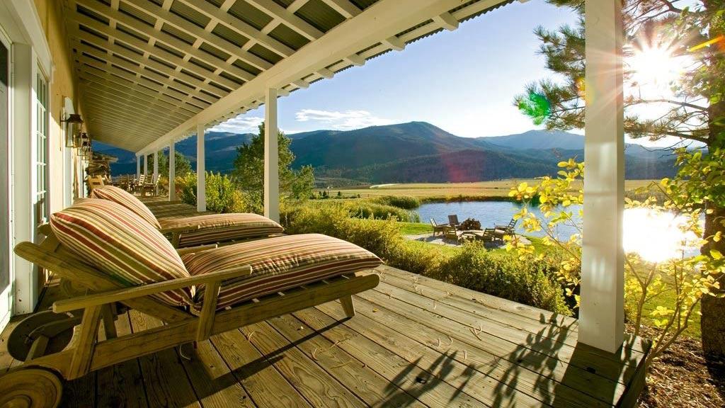 Traditional Custom Built Ranch Deck along side pond